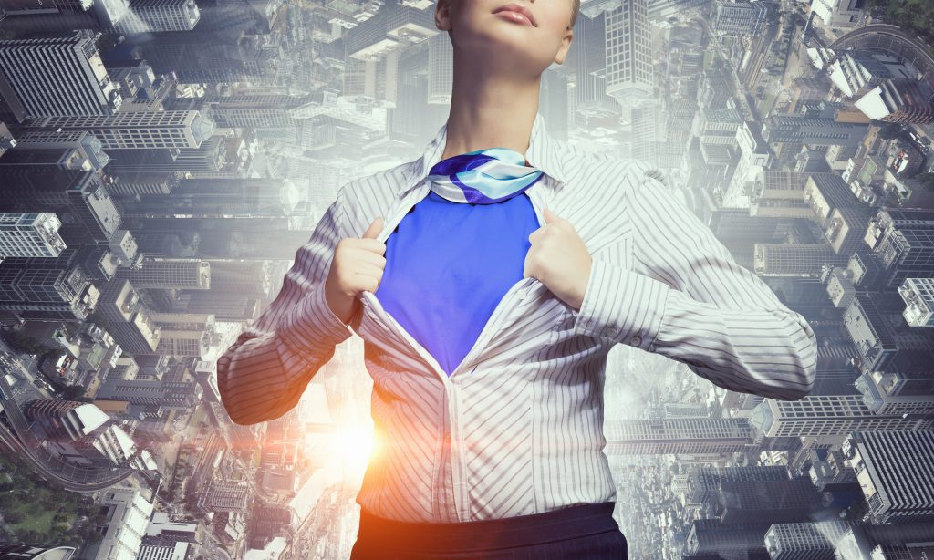 Businesswoman opening her shirt on chest like superhero